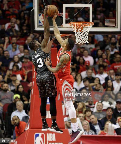 Gerald Green of the Houston Rockets blocks the shot attempt of Brandon Paul of the San Antonio Spurs at Toyota Center on March 12 2018 in Houston...