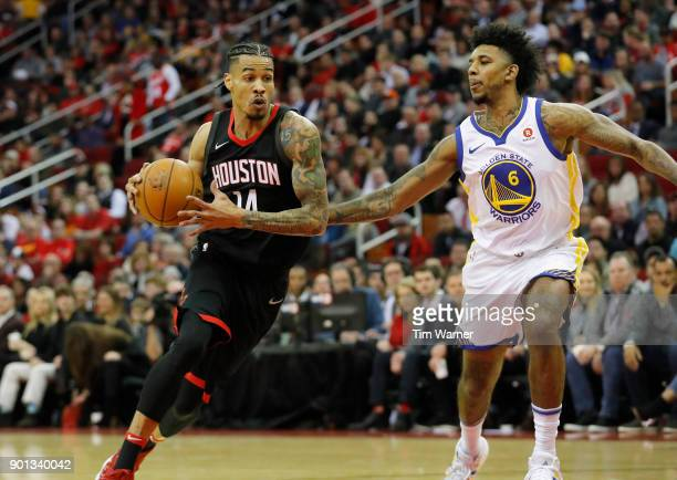 Gerald Green of the Houston Rockets drives to the basket defended by Nick Young of the Golden State Warriors in the first half at Toyota Center on...