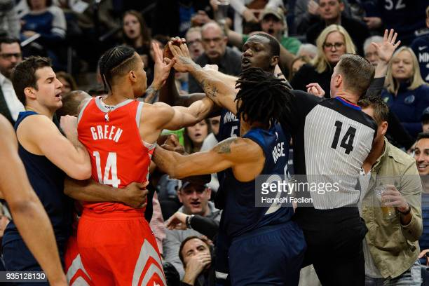 Gerald Green of the Houston Rockets gets into a altercation with Gorgui Dieng of the Minnesota Timberwolves and Derrick Rose and referee Ed Malloy...