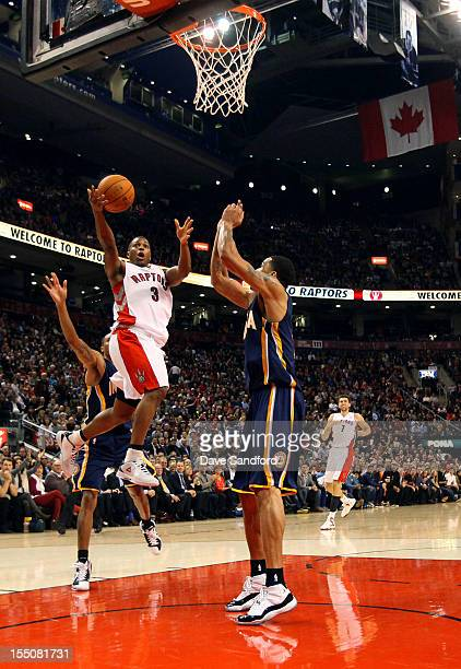Gerald Green of the Indiana Pacers defends as Kyle Lowry of the Toronto Raptors drives to the net on October 31 2012 at the Air Canada Centre in...