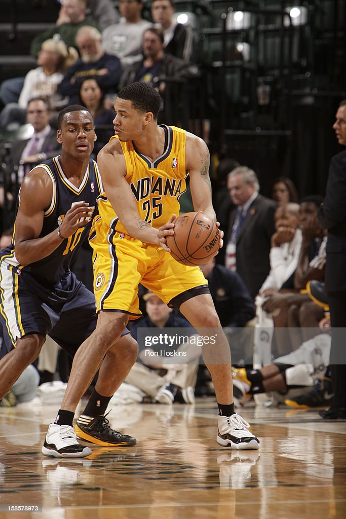 Gerald Green #25 of the Indiana Pacers protects the ball from Alec Burks #10 of the Utah Jazz during the game between the Indiana Pacers and the Utah Jazz on December 19, 2012 at Bankers Life Fieldhouse in Indianapolis, Indiana.