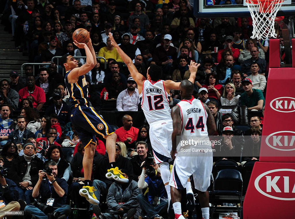 Gerald Green #25 of the Indiana Pacers shoots against John Jenkins #12 of the Atlanta Hawks on December 29, 2012 at Philips Arena in Atlanta, Georgia.