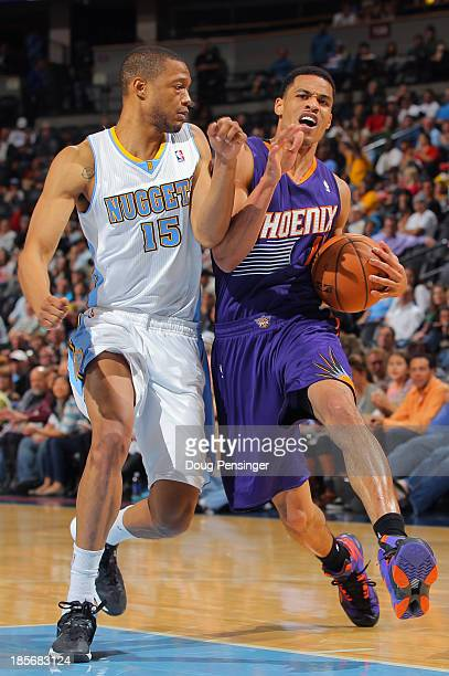 Gerald Green of the Phoenix Suns is fouled by Anthony Randolph of the Denver Nuggets as he drives to the basket during preseason action at Pepsi...