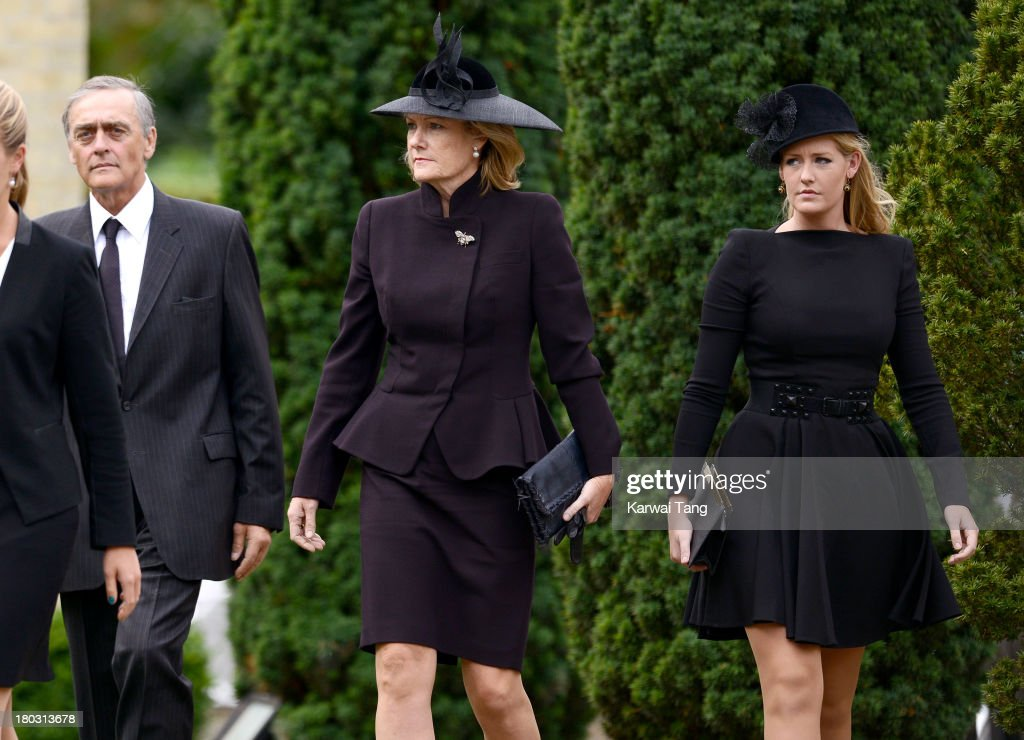 Gerald Grosvenor, Duke Of Westminster and Natalia Grosvenor, Duchess of Westminster with Lady Viola Grosvenor attend a Requiem Mass for Hugh van Cutsem who passed away on September 2nd 2013 at Brentwood Cathedral on September 11, 2013 in Brentwood, England.