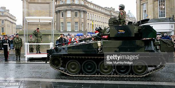 Gerald Grosvenor, The Duke of Westminster accompanies Prince Charles, Prince of Wales as he takes the salute during the parade as The Queen's Own...