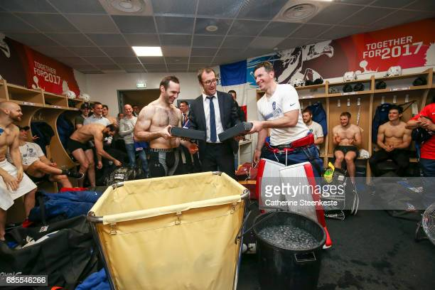 Gerald Guennelon National Technical Director of Hockey France is giving a gift in the locker room to celebrate the end of the international career of...