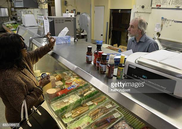 Gerald Hamel right helps serve customers at the deli counter on Monday morning Frank's Food Mart an establishment in the north Park Hill neighborhood...