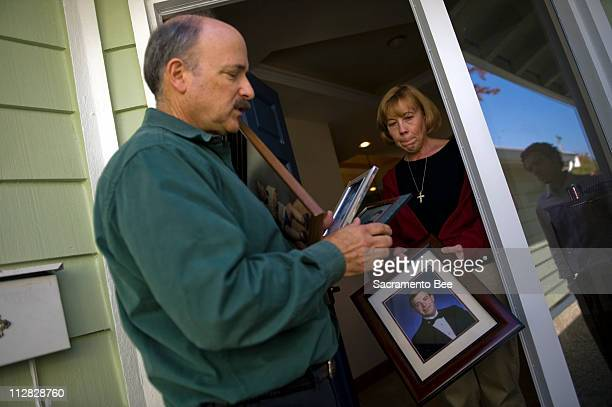 Gerald Hawkins and his wife, Elizabeth, gather photographs on October 22 at their home in Santa Clara, California, of their son, Scott who was killed...