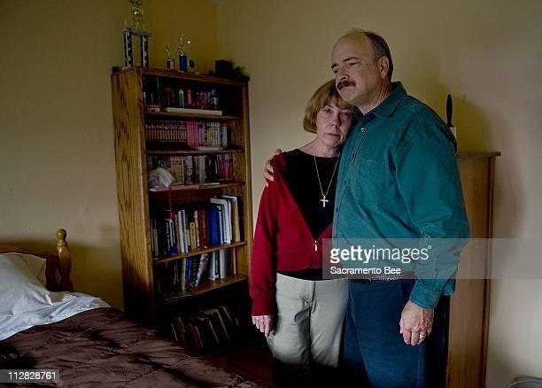 Gerald Hawkins comforts his wife, Elizabeth, in their son's bedroom in Santa Clara, California, October 22, 2009. Scott was beaten to death inside...