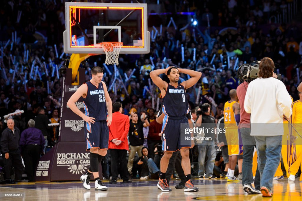 Gerald Henderson #9 and Byron Mullens #22 of the Charlotte Bobcats react after their loss to the Los Angeles Lakers at Staples Center on December 18, 2012 in Los Angeles, California.
