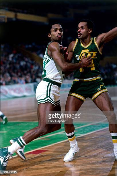 Gerald Henderson of the Boston Celtics boxes out against Rickey Green of the Utah Jazz during an NBA game played in 1984 at the Boston Garden in...