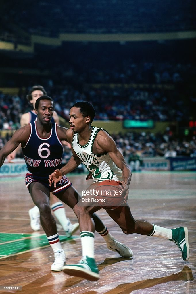 Gerald Henderson #43 of the Boston Celtics drives to the basket against Trent Tucker #6 of the New York Knicks during a game played in 1983 at the Boston Garden in Boston, Massachusetts.