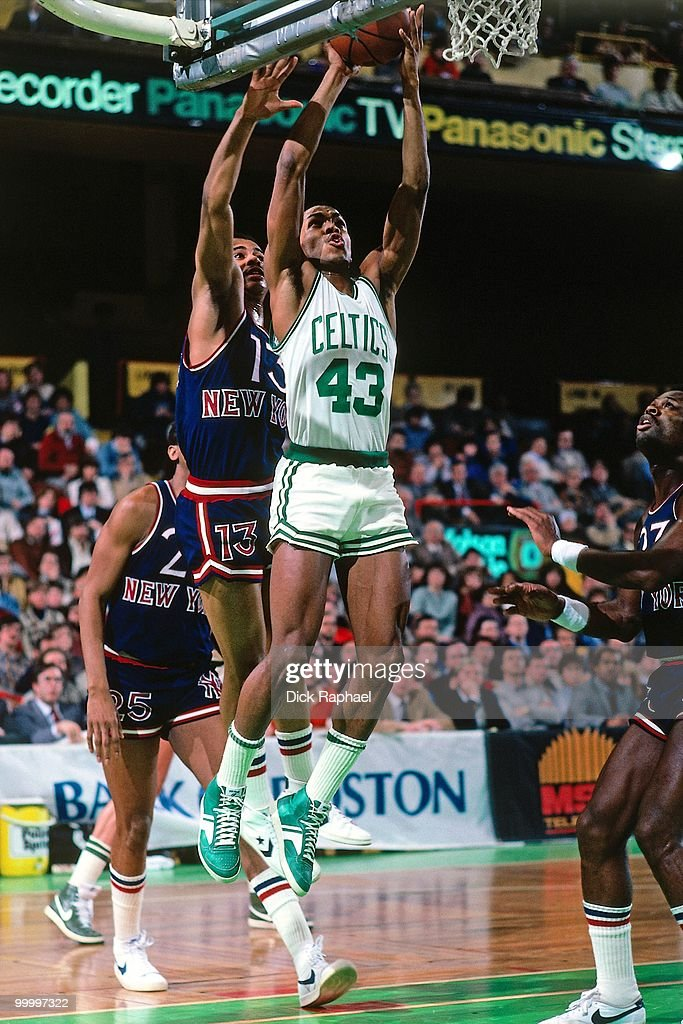 Gerald Henderson #43 of the Boston Celtics goes up for a shot against the New York Knicks during a game played in 1983 at the Boston Garden in Boston, Massachusetts.
