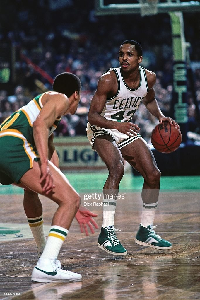 Gerald Henderson #43 of the Boston Celtics looks to make a move against the Seattle Supersonics during a game played in 1983 at the Boston Garden in Boston, Massachusetts.