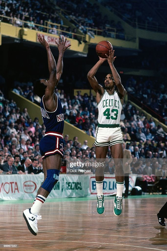 Gerald Henderson #43 of the Boston Celtics shoots a jump shot against the New York Knicks during a game played in 1983 at the Boston Garden in Boston, Massachusetts.