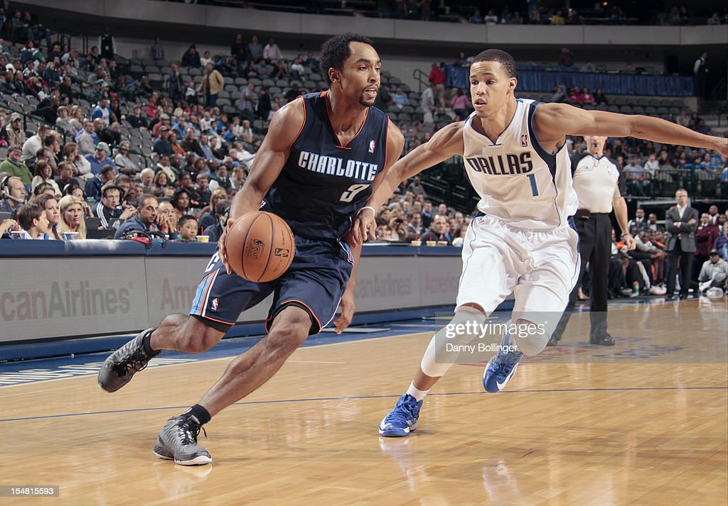 Gerald Henderson #9 of the Charlotte Bobcats drives against Jared Cunningham #1 of the Dallas Mavericks on October 26, 2012 at the American Airlines Center in Dallas, Texas.