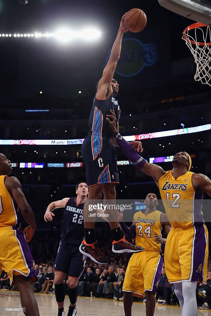 Gerald Henderson #9 of the Charlotte Bobcats dunks over Dwight Howard #12 of the Los Angeles Lakers in the second half at Staples Center on December 18, 2012 in Los Angeles, California. The Lakers defeated the Bobcats 101-100.