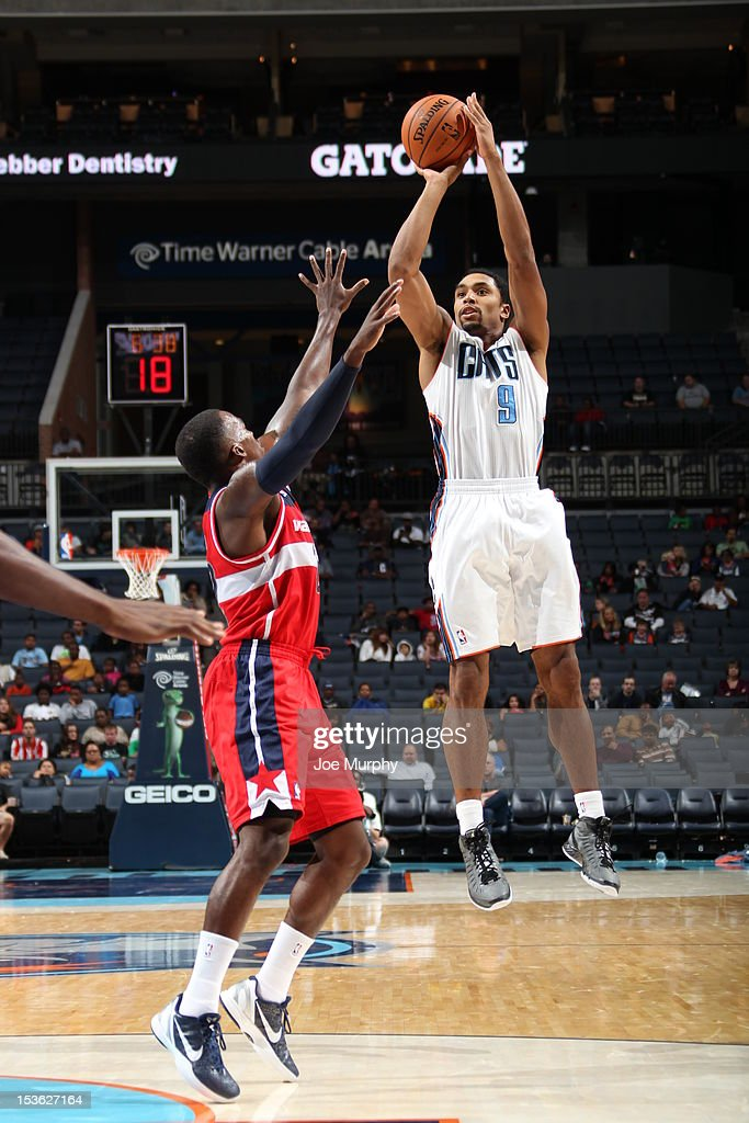 Gerald Henderson #9 of the Charlotte Bobcats goes for a jump shot during the game between the Charlotte Bobcats and the Washington Wizards at the Time Warner Cable Arena on October 7, 2012 in Charlotte, North Carolina.