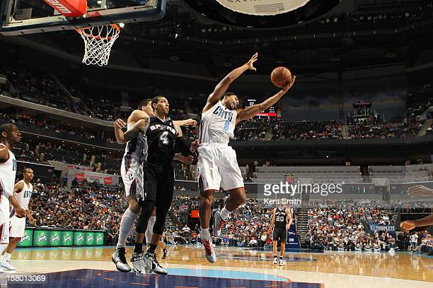 6b89f55f0a3c6 Gerald Henderson of the Charlotte Bobcats grabs the rebound against Danny  Green of the San Antonio