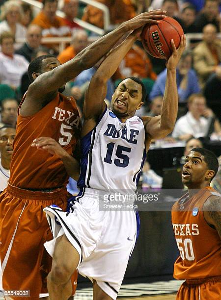Gerald Henderson of the Duke Blue Devils battles for a rebound against Damion James and Varez Ward of the Texas Longhorns during the second round of...