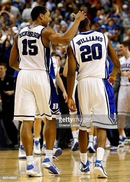 Gerald Henderson of the Duke Blue Devils celebrates with Elliot Williams in the final seconds of their 74-69 loss to the Texas Longhorns during the...
