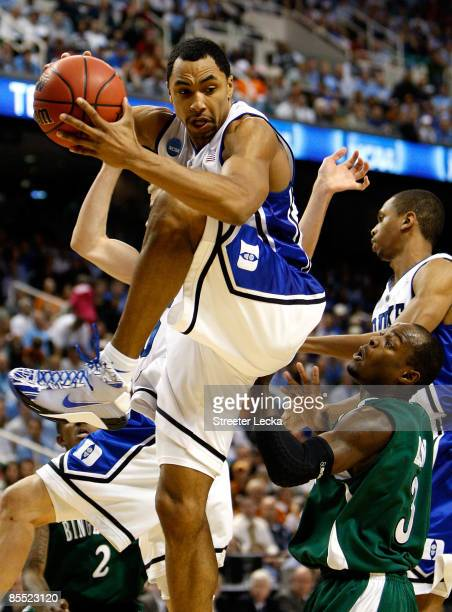 Gerald Henderson of the Duke Blue Devils grabs a rebound against Malik Alvin of the Binghamton Bearcats during the first round of the NCAA Division I...