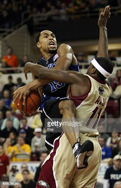 Gerald Henderson of the Duke Blue Devils is fouled by Corey Raji of the Boston College Eagles on February 15 2009 at Conte Forum in Chestnut Hill...
