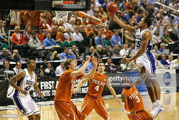 Gerald Henderson of the Duke Blue Devils lays in a basket against A.J. Abrams and Clint Chapman of the Texas Longhorns during the second round of the...
