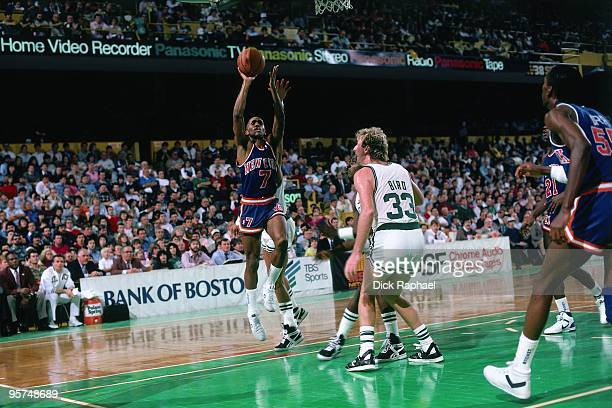 Gerald Henderson of the New York Knicks shoots a jumper against Larry Bird of the Boston Celtics during a game played in 1987 at the Boston Garden in...