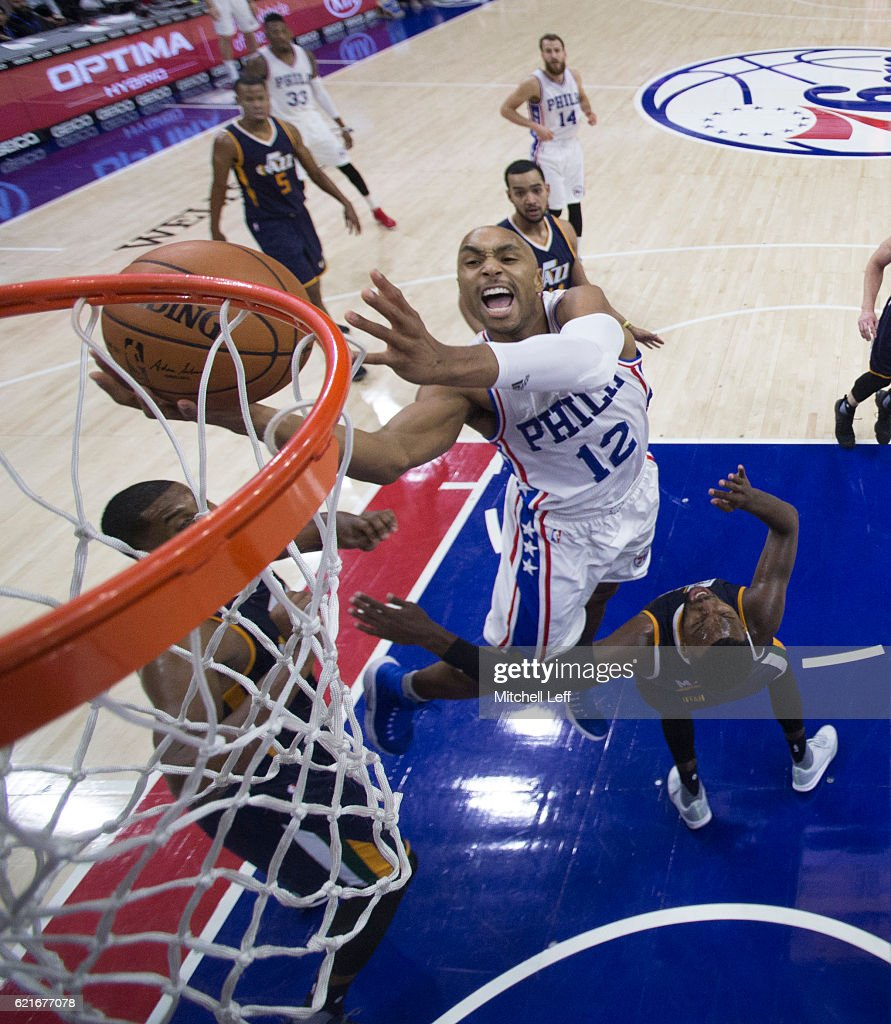 Gerald Henderson #12 of the Philadelphia 76ers charges into Shelvin Mack #8 of the Utah Jazz in the third quarter at Wells Fargo Center on November 7, 2016 in Philadelphia, Pennsylvania. The Jazz defeated the 76ers 109-84.