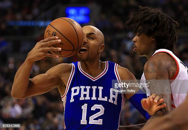 Gerald Henderson of the Philadelphia 76ers loses control of the ball as Lucas Nogueira of the Toronto Raptors defends during the first half of an NBA...