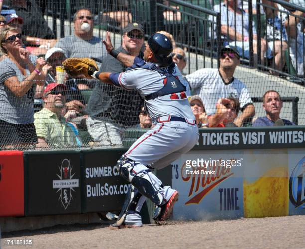 Gerald Laird of the Atlanta Braves catches a foul ball off the bat of Adam Dunn of the Chicago White Sox during the third inning on July 21 2013 at...