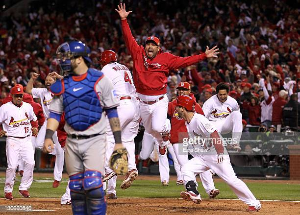 Gerald Laird of the St Louis Cardinals celebrates after David Freese hits a walk off solo home run in the 11th inning to win Game Six of the MLB...