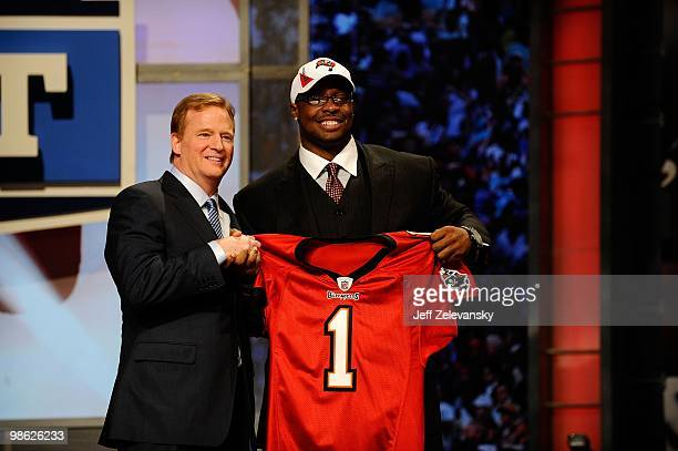 Gerald McCoy from the Oklahoma Sooners poses with NFL Commissioner Roger Goodell as they hold a Tampa Bay Buccaneers jersey after McCoy was selected...