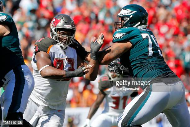 Gerald McCoy of the Bucs rushes the passer as Brandon Brooks of the Eagles blocks on the play during the regular season game between the Jacksonville...