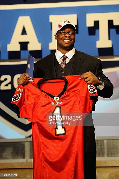 Gerald McCoy of the Oklahoma Sooners celebrates as he holds a Tampa Bay Buccaneers jersey after he was picked third overall by Tampa Bay during the...