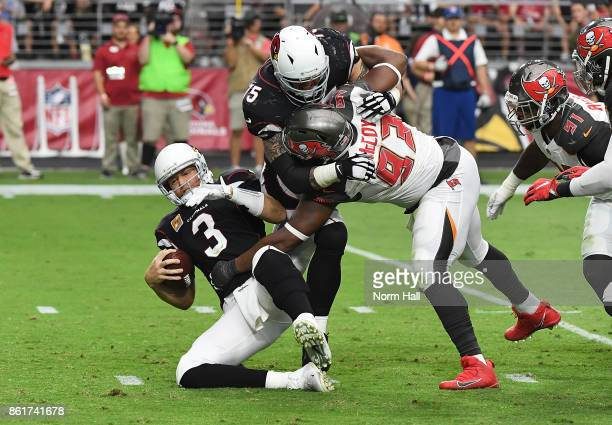 Gerald McCoy of the Tampa Bay Buccaneers fights through a block by Alex Boone of the Arizona Cardinals to sack Carson Palmer during the fourth...