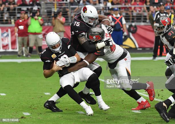 Gerald McCoy of the Tampa Bay Buccaneers fights through a block by Alex Boone of the Arizona Cardinals to sack Carson Palmer during the second half...
