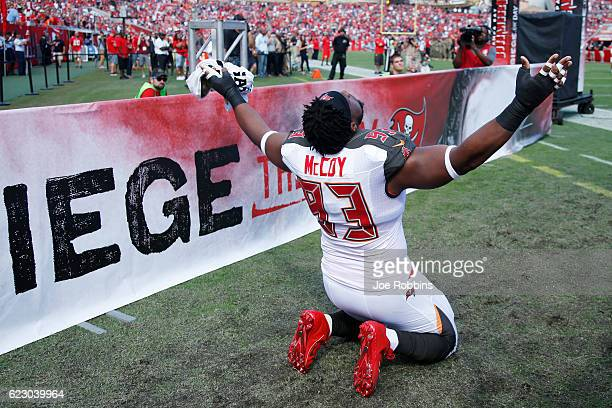 Gerald McCoy of the Tampa Bay Buccaneers kneels as he is introduced before the game against the Chicago Bears at Raymond James Stadium on November 13...
