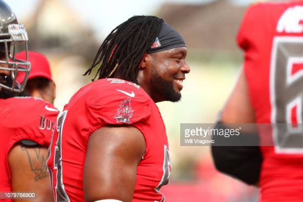 Gerald McCoy of the Tampa Bay Buccaneers looks on during warmups before a game against the New Orleans Saints at Raymond James Stadium on December 09...