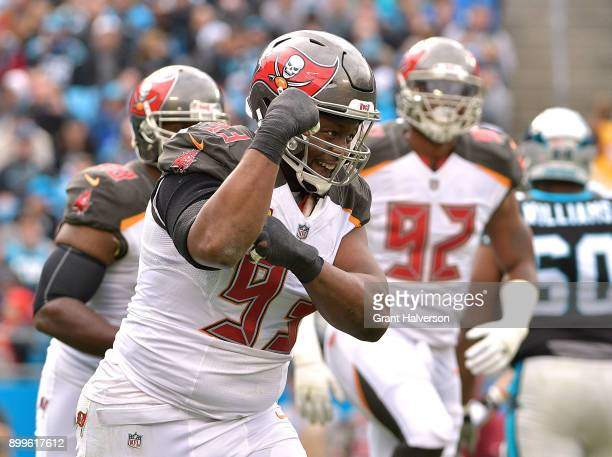 Gerald McCoy of the Tampa Bay Buccaneers reacts after sacking Cam Newton of the Carolina Panthers during their game at Bank of America Stadium on...