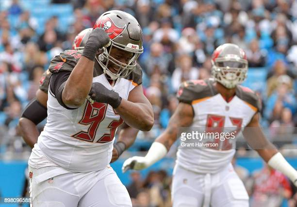 Gerald McCoy of the Tampa Bay Buccaneers reacts after scaking Cam Newton of the Carolina Panthers during their game at Bank of America Stadium on...