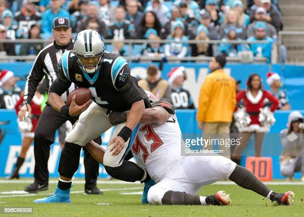 Gerald McCoy of the Tampa Bay Buccaneers sacks Cam Newton of the Carolina Panthers during their game at Bank of America Stadium on December 24 2017...