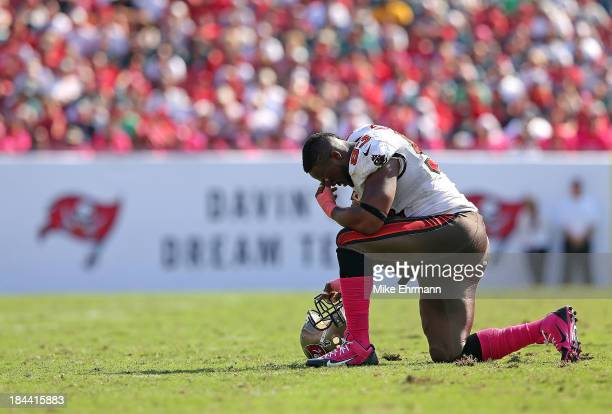 Gerald McCoy of the Tampa Bay Buccaneers takes a knee during a game against the Philadelphia Eagles at Raymond James Stadium on October 13 2013 in...