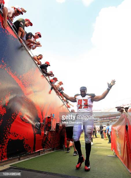 Gerald McCoy of the Tampa Bay Buccaneers walks off the field after winning a game against the Philadelphia Eagles at Raymond James Stadium on...