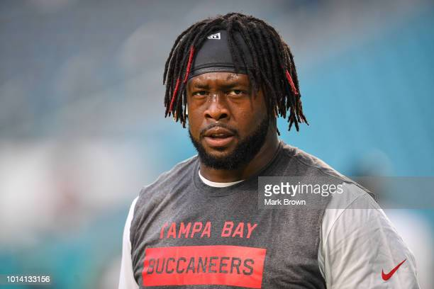 Gerald McCoy of the Tampa Bay Buccaneers warms up before the preseason game against the Miami Dolphins at Hard Rock Stadium on August 9 2018 in Miami...