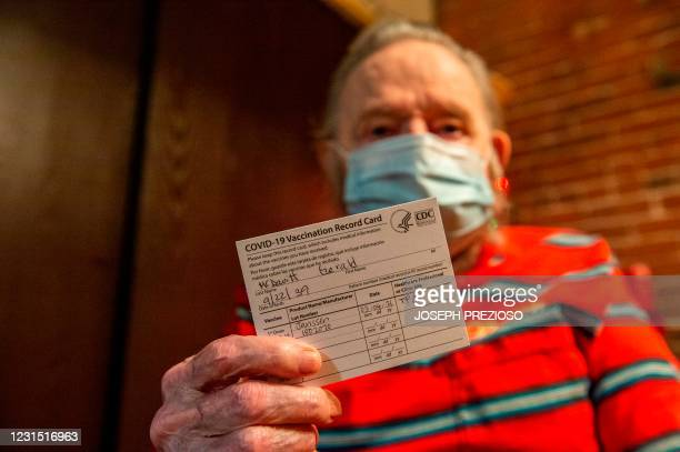 Gerald McDavitt a Veteran of the United States Army Corps of Engineers, holds his CDC vaccine card after being inoculated with the Johnson & Johnson...