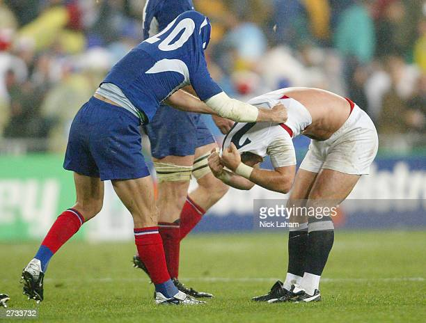 Gerald Merceron of France swaps his jersey with Mike Tindall of England during the Rugby World Cup SemiFinal match between England and France at...