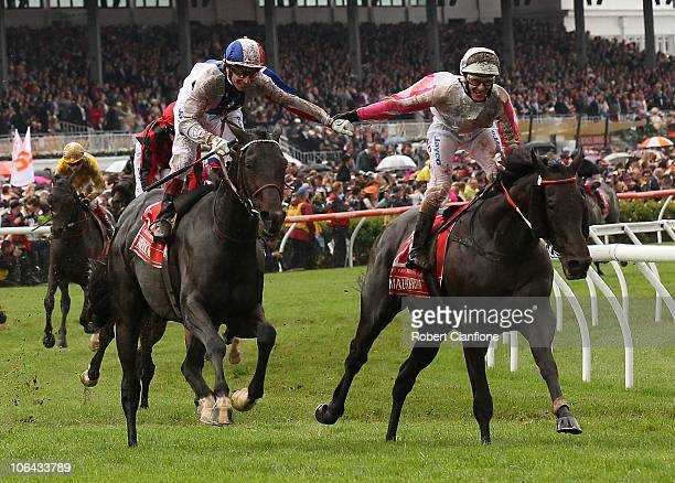 Gerald Mosse riding Americain is congratulated by Luke Nolen riding Maluckyday after winning race seven the Emirates Melbourne Cup during Melbourne...