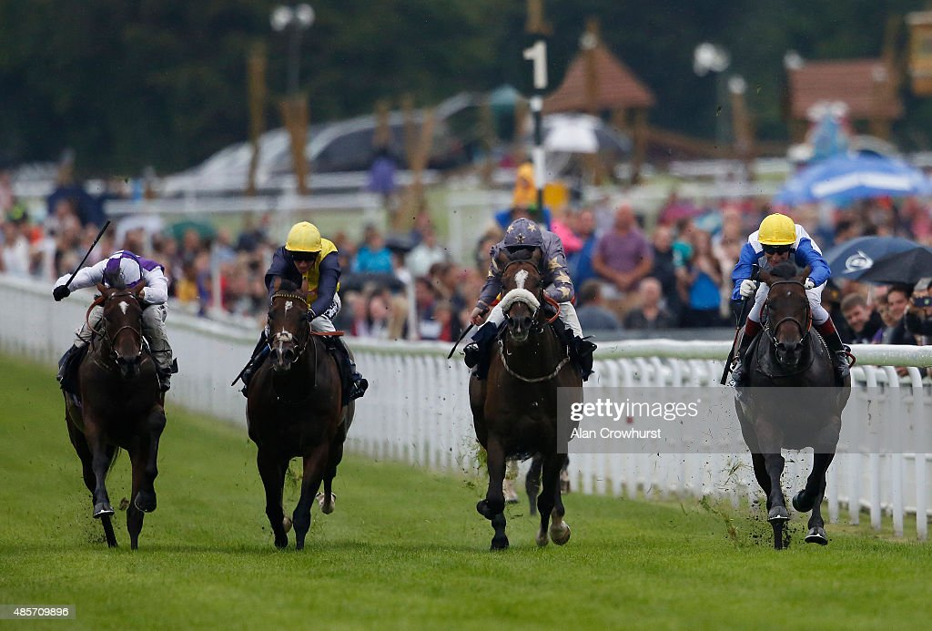 Gerald Mosse riding Kodi Bear (R) win The Doom Bar Celebration Mile at Goodwood racecourse on August 29, 2015 in Chichester, England.